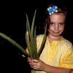 My daughter in Fiji in the early 90s with the bean like pods