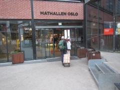 Entering Oslo Food Hall with books in tow -- <p>