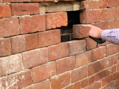 Inspecting the heated cavity in the wall -- Inspecting the heated cavity in the wall